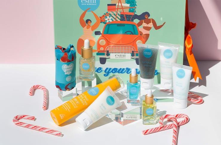 a colourful box with beauty products in front of it.