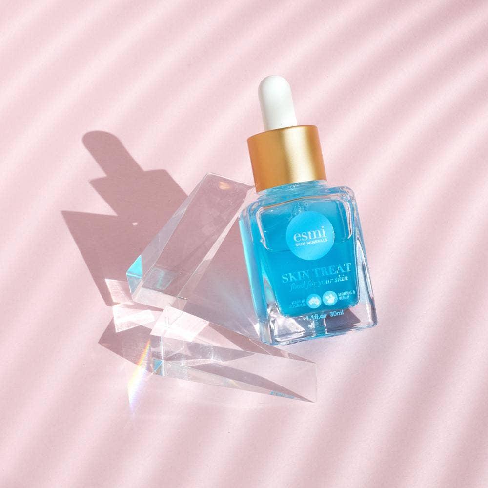 a bottle of blue serum