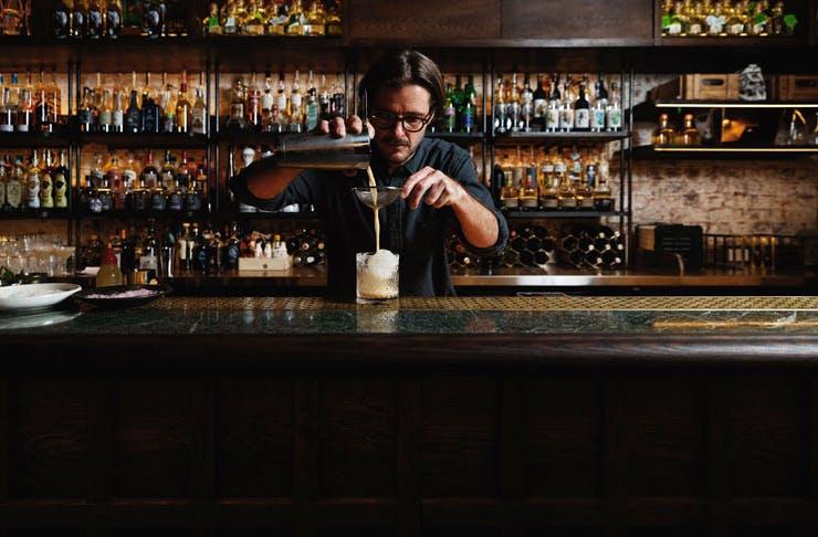 A barman pouring a cocktail at Esteban.