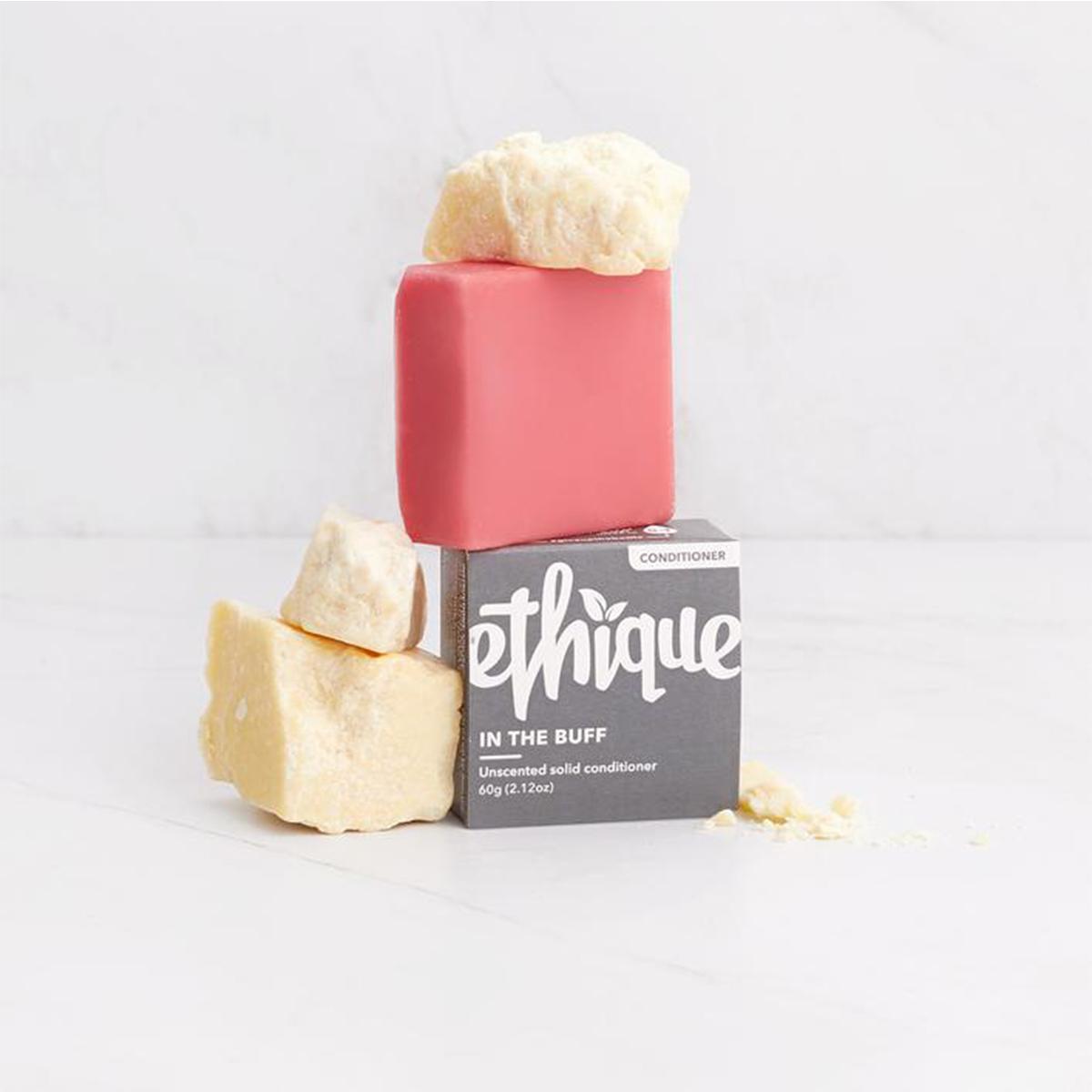 A box and naked shampoo bar, arranged for a photo.