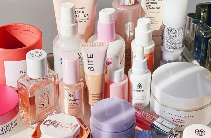 A collection of beauty and makeup products displayed on a table.