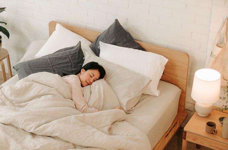 A woman sleeping on an Eva Mattress.