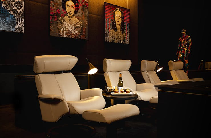 Plush white leather chairs at the Gallery in Event Cinemas Newmarket.