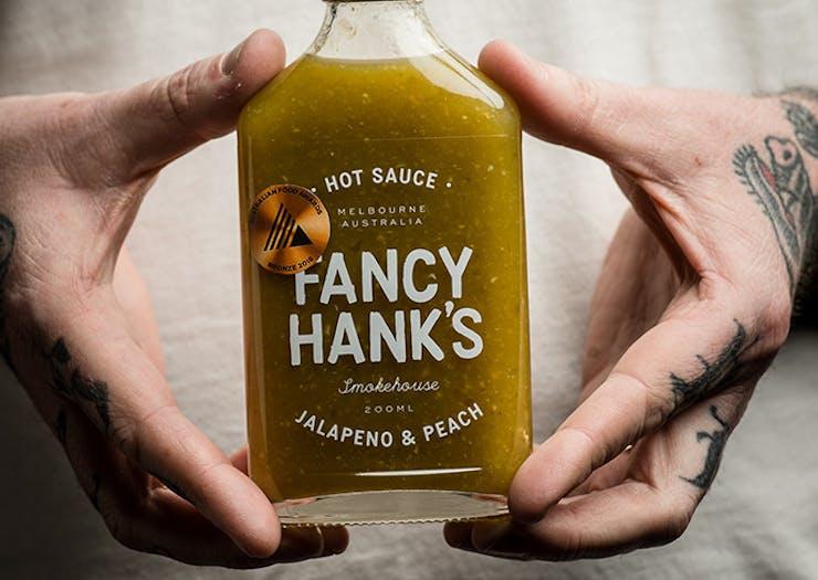 Finally, Fancy Hanks Is Releasing Its Own Brand Of Hot Sauce
