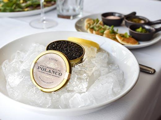 a small tin of caviar on ice