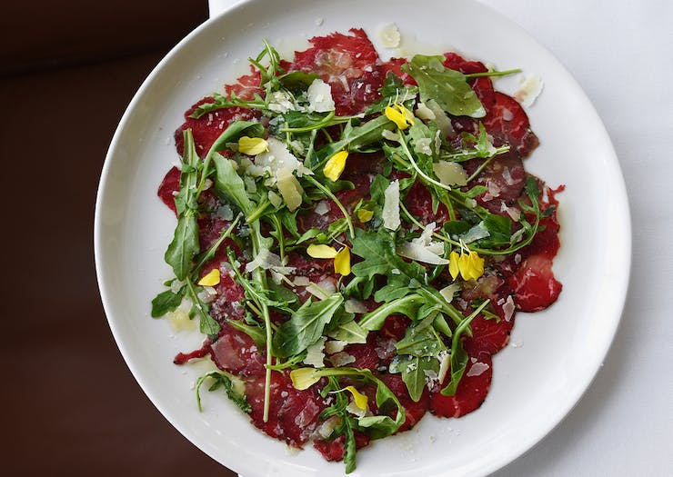a plate of beef carpaccio