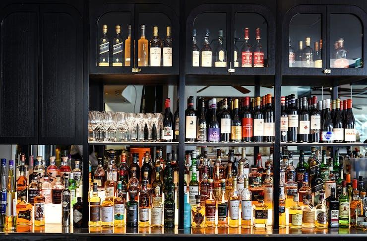 a black bar full of bottles