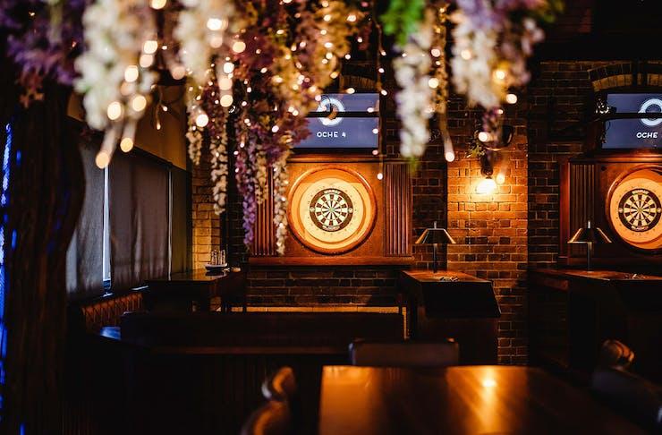 digital darts board in a bar
