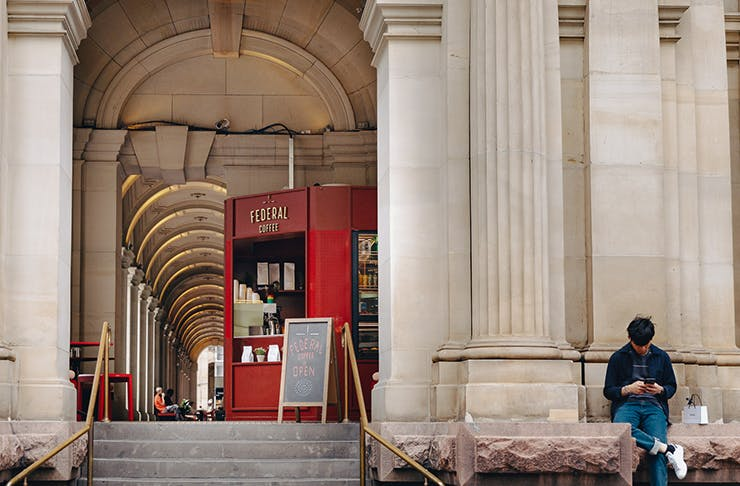 A coffee stand set within the large concrete pillars of Melbourne's GPO building.