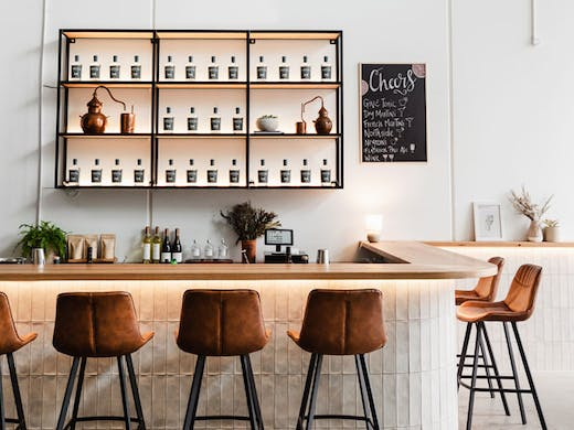 The white-tiled bar at Finders Distillery in North Sydney.