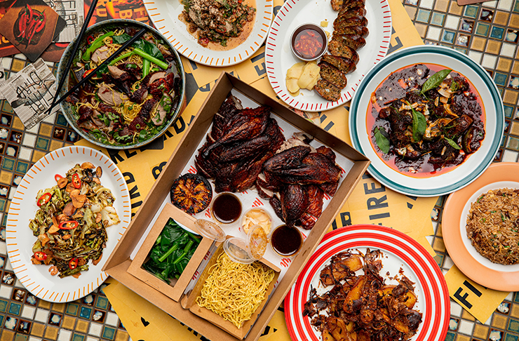 A spread of Vietnamese food from restaurant Firebird, with crispy chicken wings as the hero in the middle.
