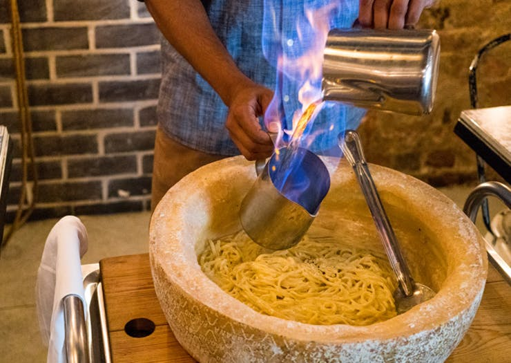 These Guys Are Making Pasta From Flaming Wheels Of Cheese