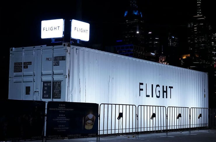 White shipping container with the word FLIGHT on the side