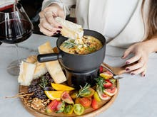 Warm Up With A 10-Cheese Fondue And Two Hours Of Bottomless Wine For Just $39