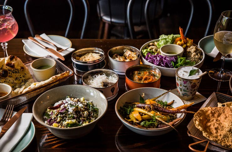 Bowls of curry, naan, and more from Foreign Return restaurant.