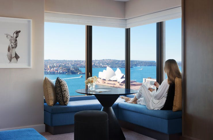 A girl relaxing in one of the harbour suites at the Four Seasons hotel in Sydney.