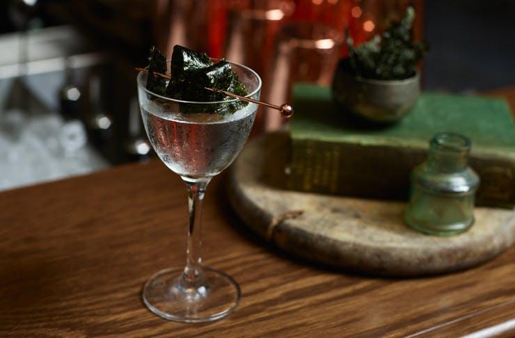 A martini with a seawood garnish