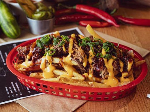 a basket of loaded fries
