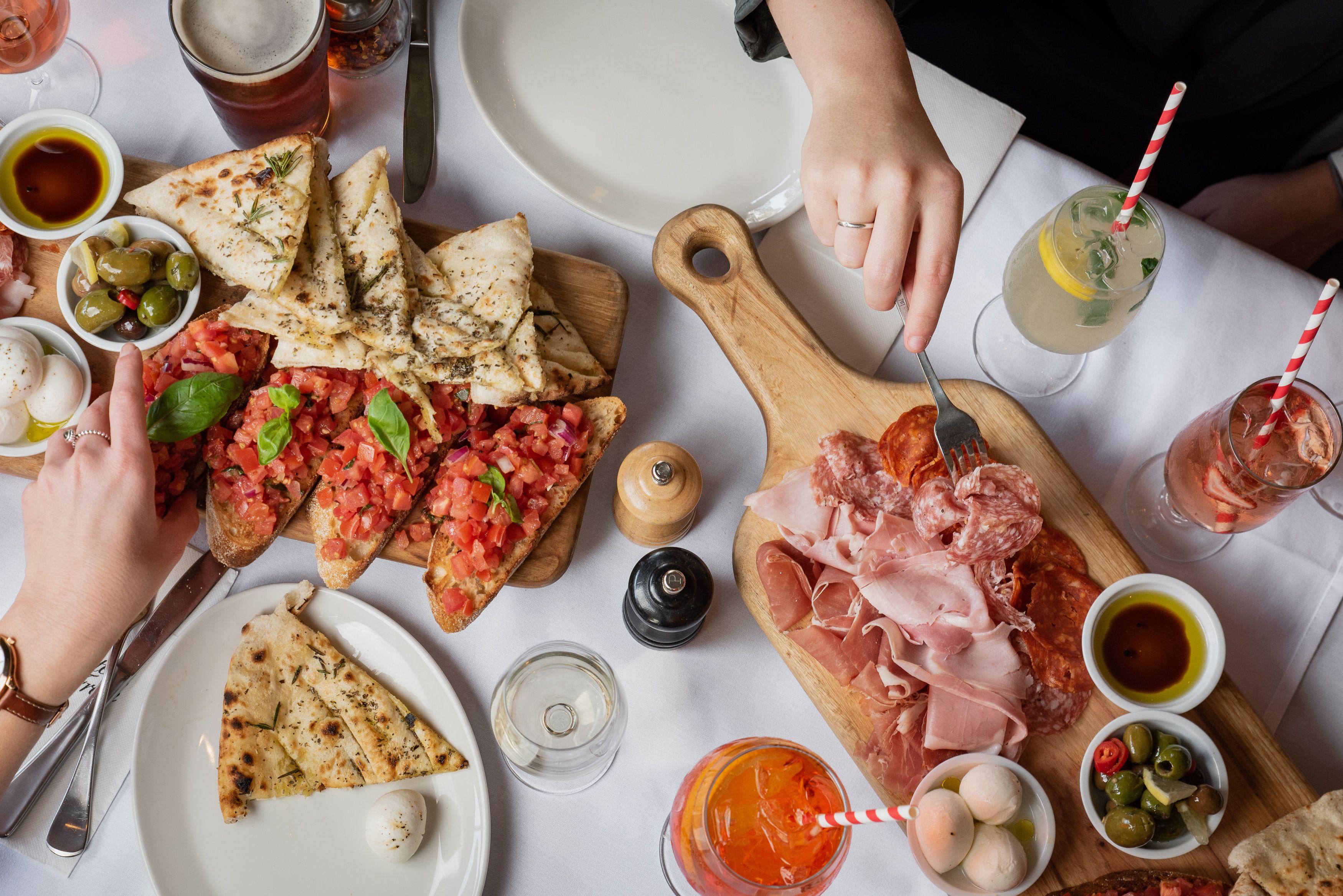 a table full of italian fare