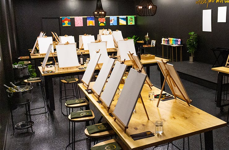 a paint-and-sip studio with black walls