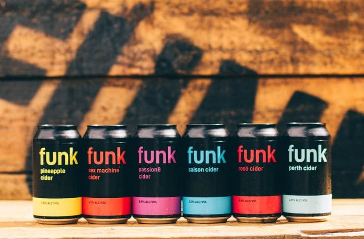 Six cans of Funk Cider lines up on table
