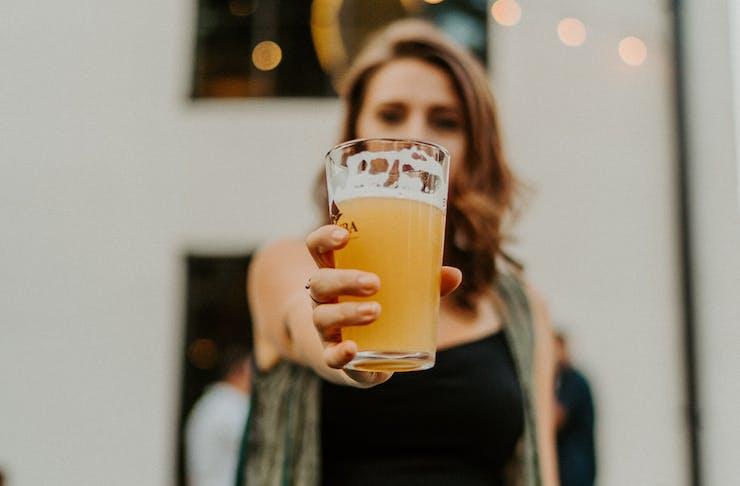 a woman holding a beer