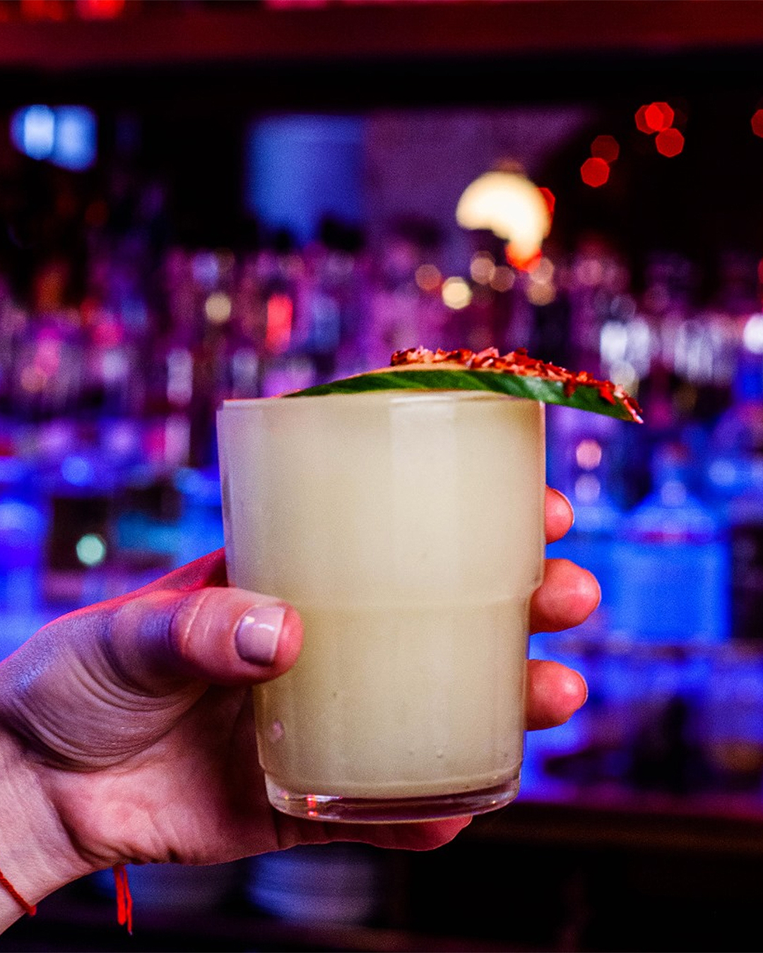 A hand holds the stealth margarita at Ghost Donkey.