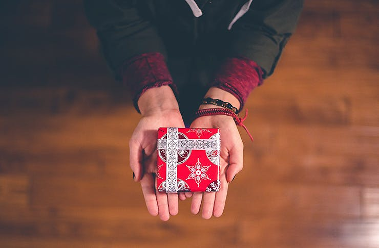 A person offering a small gift