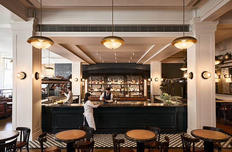 Gimlet's main bar adorned by two white pillars and filled with natural light.