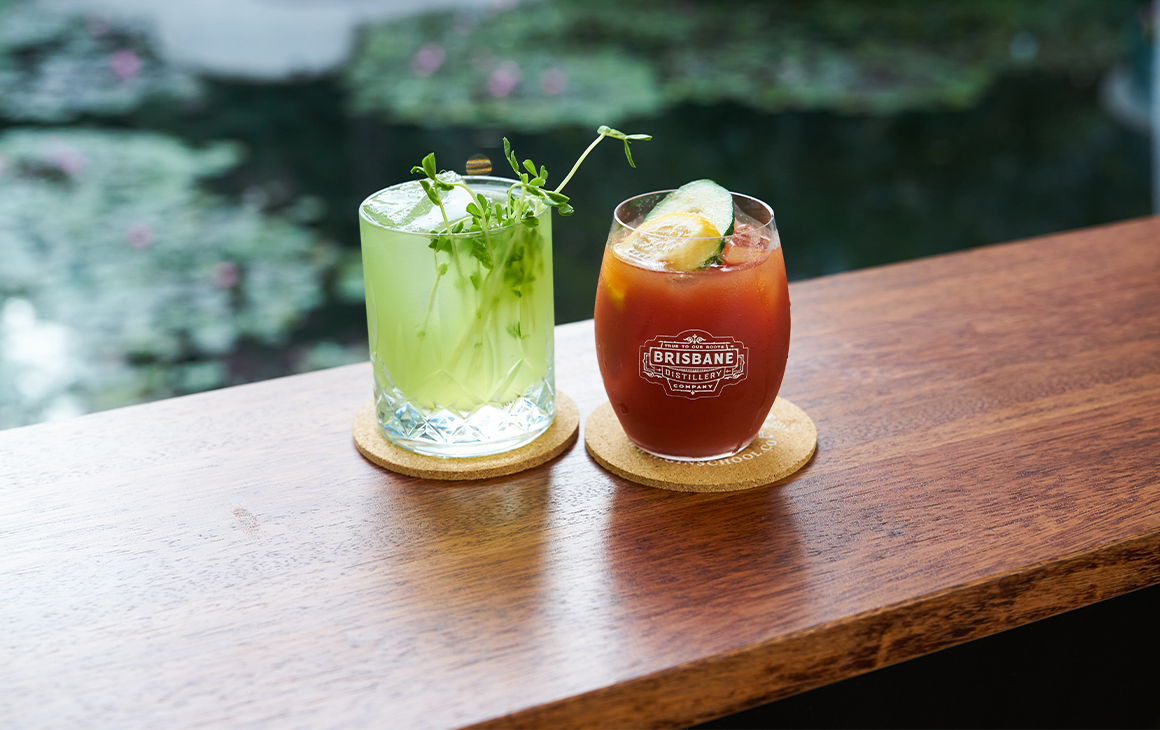 two cocktails on a bench