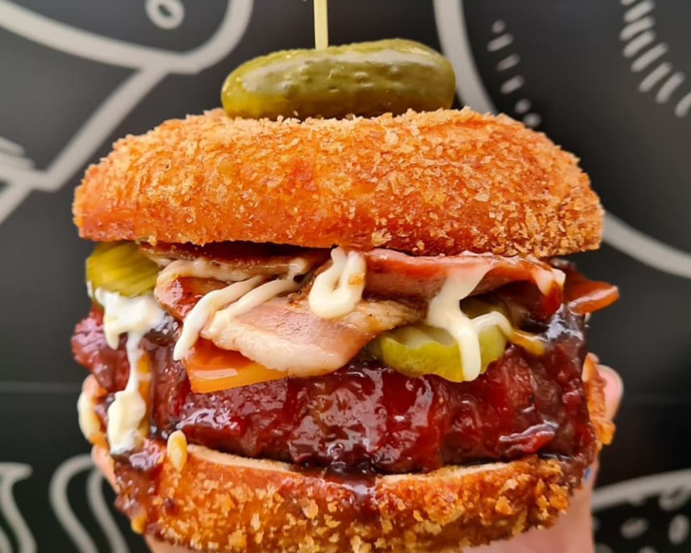 Meatloaf with streaky smoked bacon, honey bourbon glaze, smoked cheese, pickles and mayonnaise in a crumbed housemade donut bun, with crinkle-cut fries ($25)
