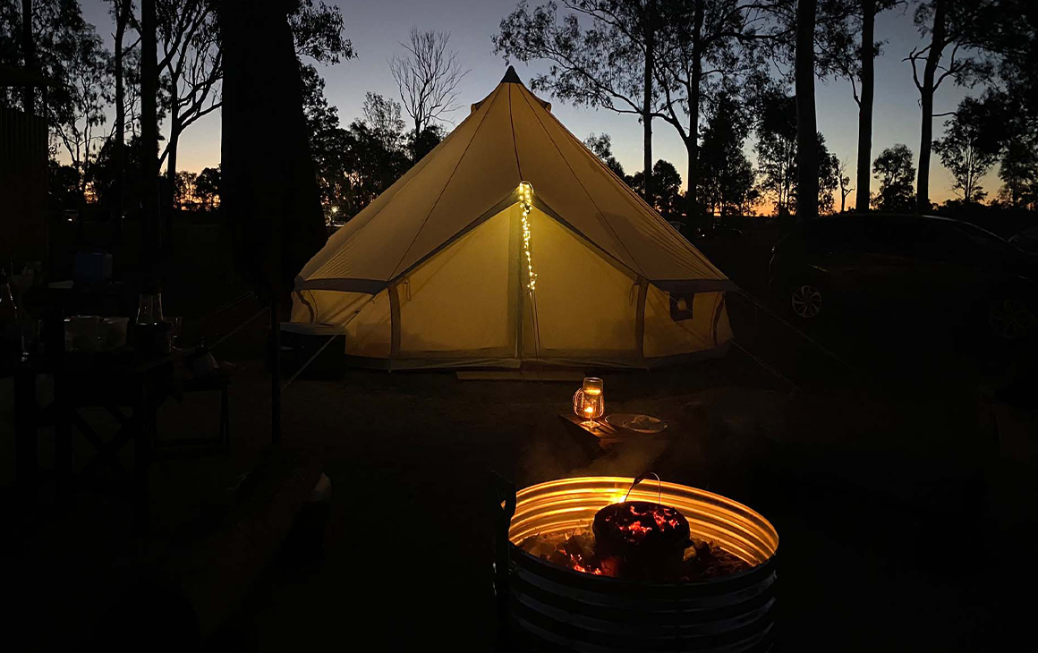 a canvas tent with a campfire