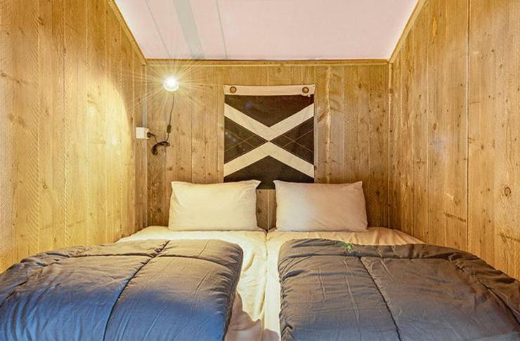 a double bed in a wooden nook