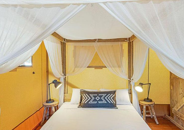 A four poster bed with curtains