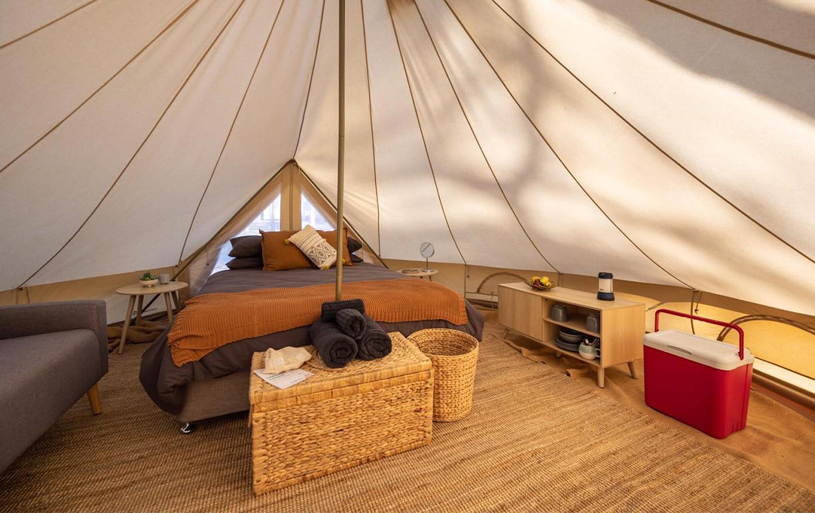 the inside bedroom section of a cotton bell tent
