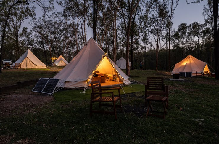 a cotton bell tent with fairy lights