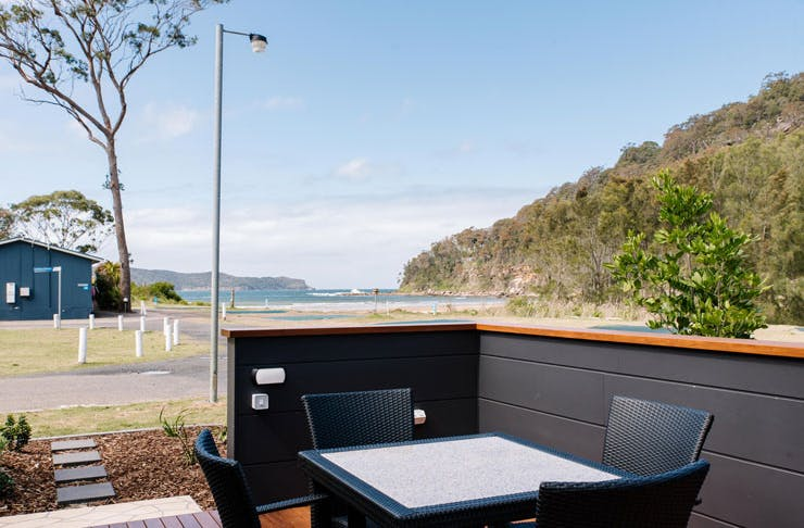 The entertaining area at the NRMA Glamtainer with a view of the beach.