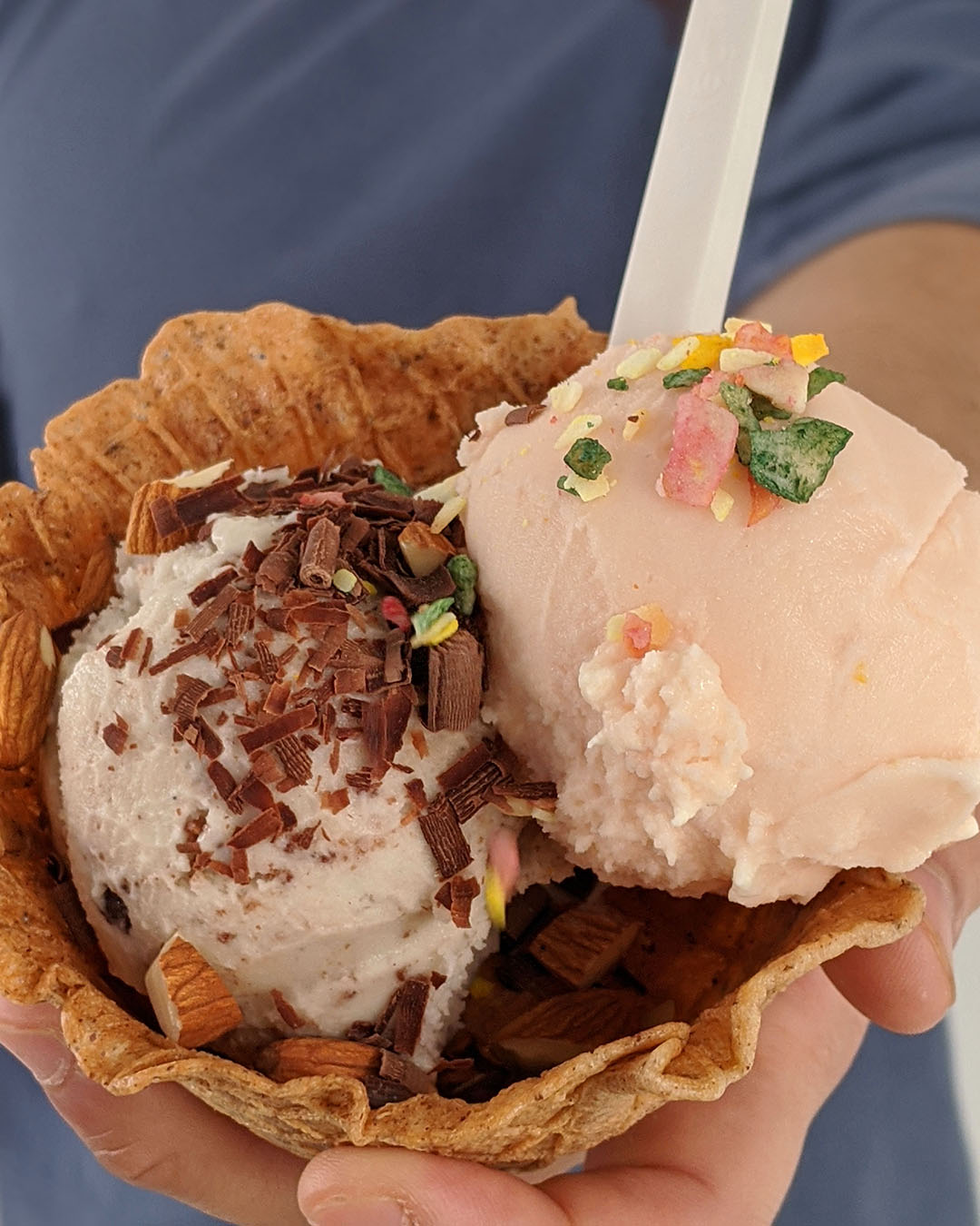 Good Habit ice cream held out in a waffle cone.