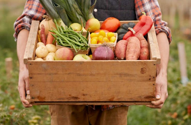 A wooden box of fresh fruit and vegetables