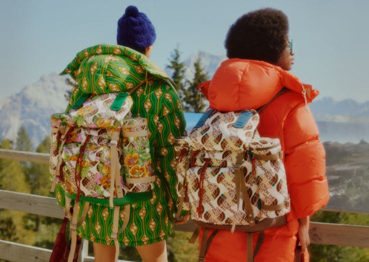 Two people with The North Face x Gucci backpacks on.