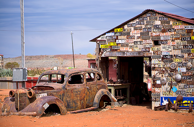A derelict car in the empty streets of Gwalia, Western Australia.