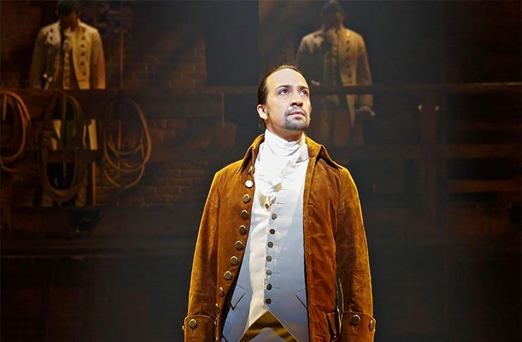 A photo of Lin-Manuel Miranda as Alexander Hamilton in a production of Hamilton the musical.