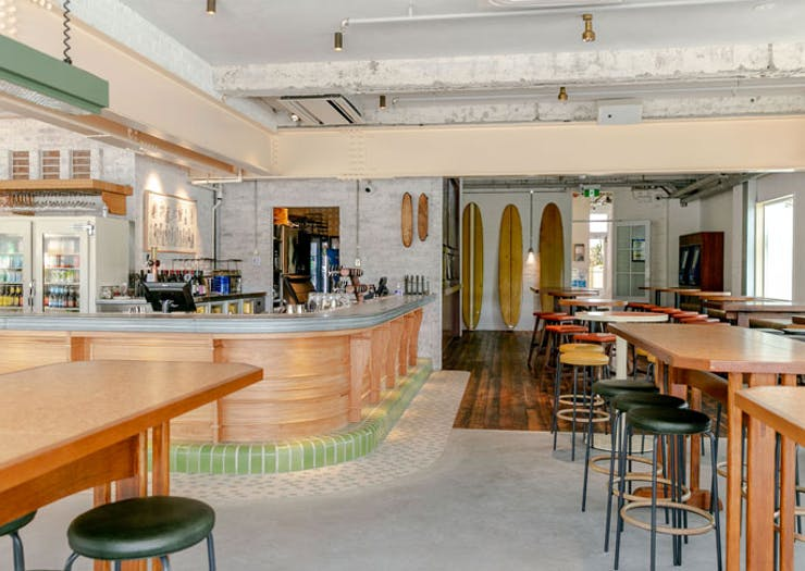 A bar and high tables at the new Harbord Hotel.