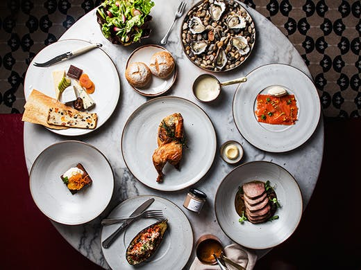 A top down shot of a luxurious feast from Hemingway's Dining Room.
