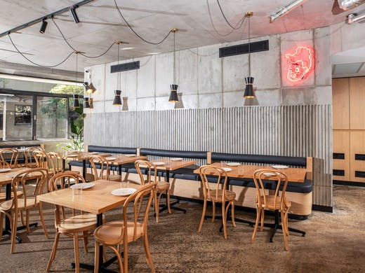 The dining room and interior of Surry Hills charcoal chicken restaurant, Henrietta.