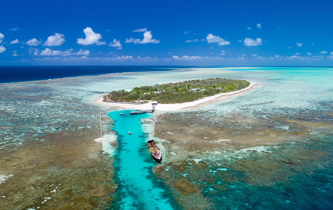 a small island surrounded by reefs