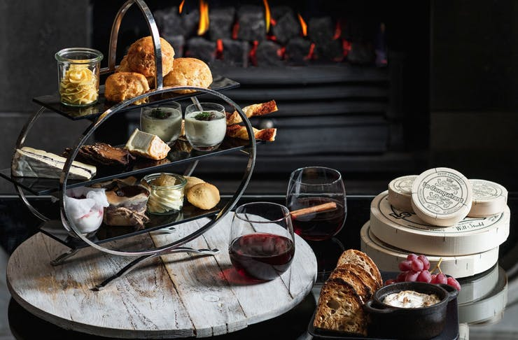 The Westin's High Cheese event. Savoury and sweet cheese treats can be seen on a classic high tea stand.