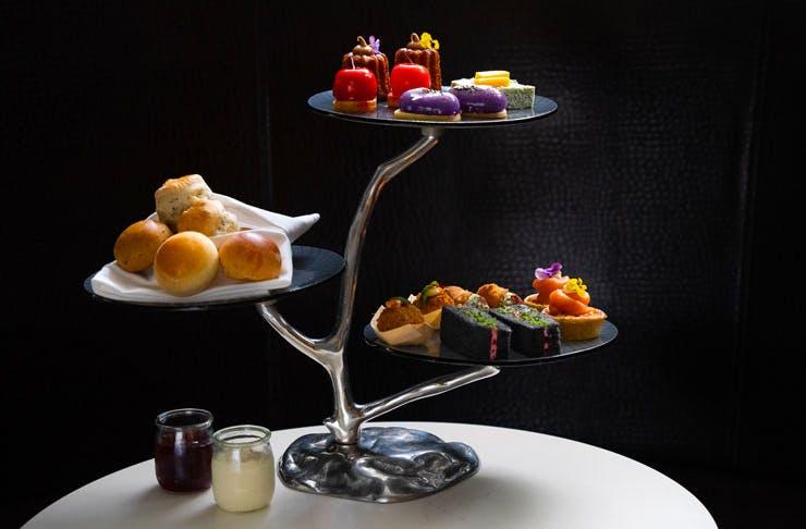 High tea set out on a sculptural cake stand