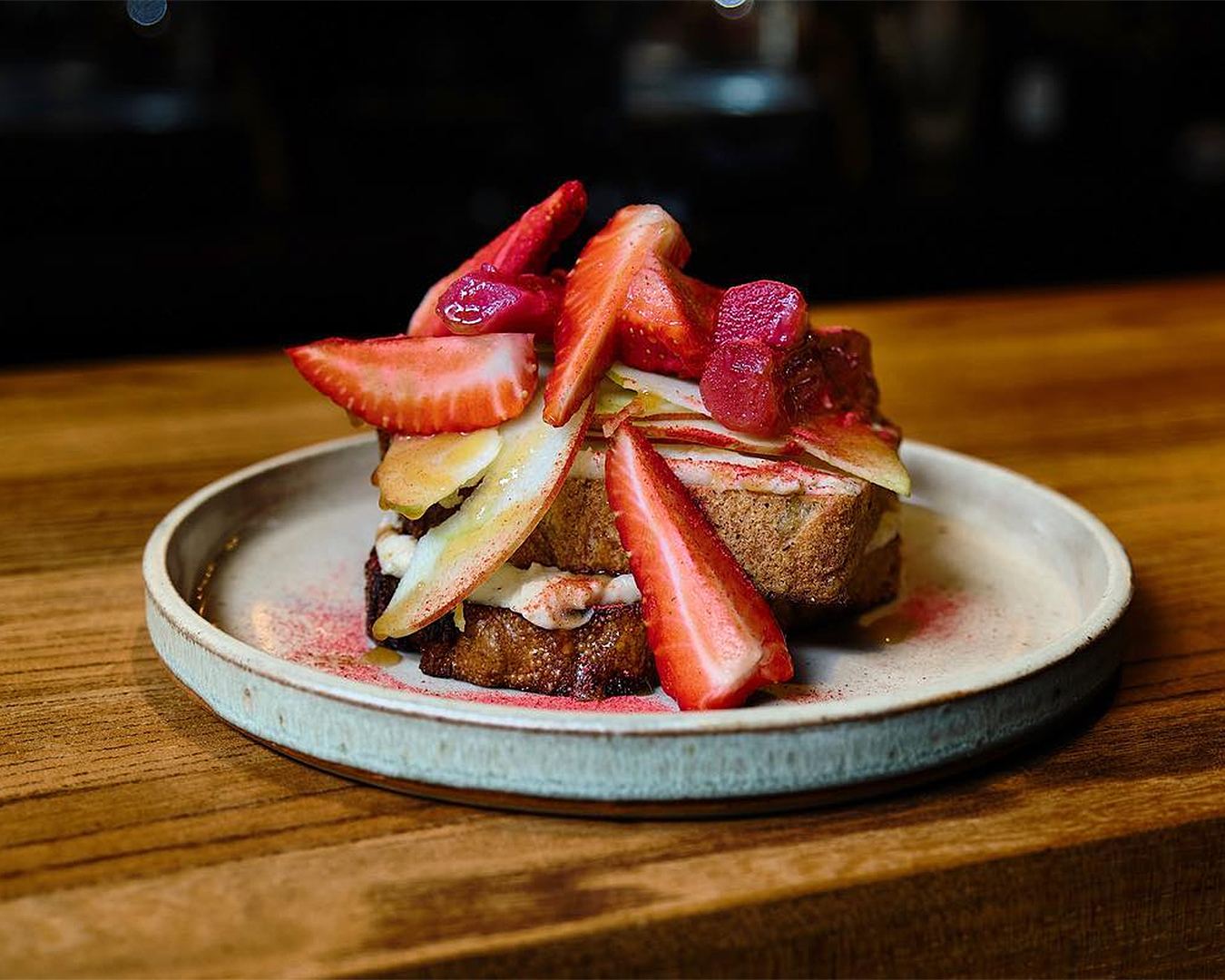 Fruit Toast whipped spiced ricotta, apple, rose poached rhubarb, strawberries, honey