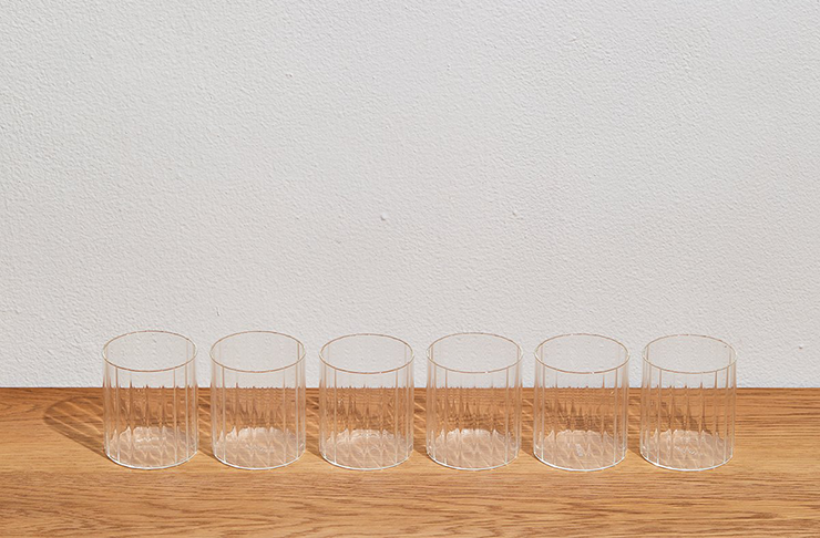 Six alcohol tumblers in a row, a set of absolute home bar essentials.
